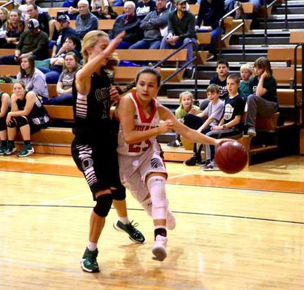 Baylea Perez turns the corner and      drives the lane.