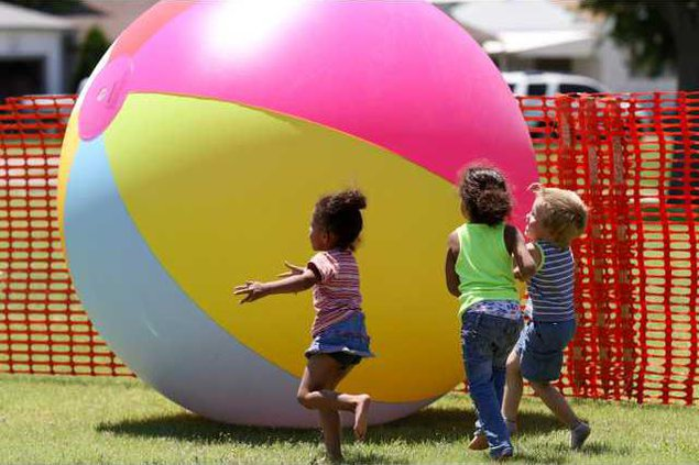 A giantic beach ball was enjoyed by all ages.