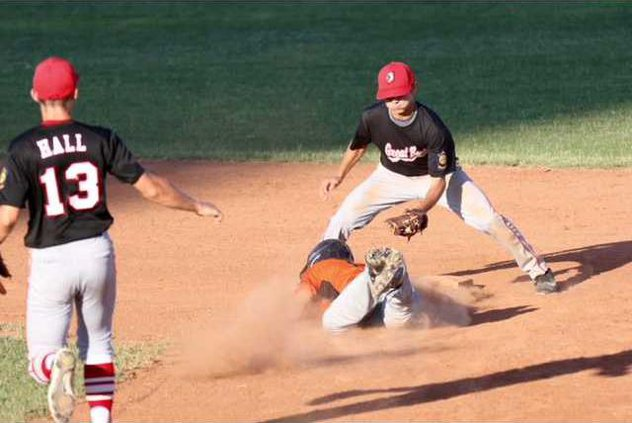 Austin Gladow gets caught in a run down between first and second but beats the throw and is safe at second base.