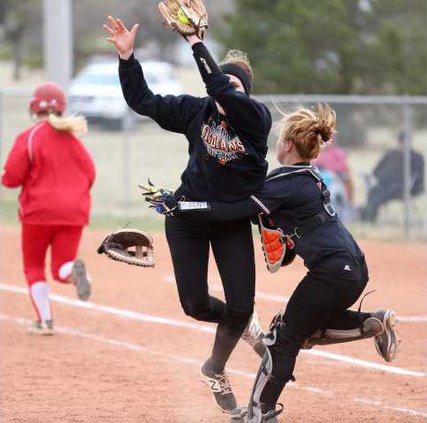 First baseman Lynzi Myrick and catcher Shaylee Martin collide but Myrick hangs on to the ball for the second out of the inning.