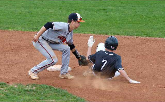Larned27s Carson Smith puts the tag on Ty Miller