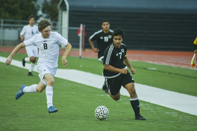 spt_HG_Great Bend Panther's Dani Franco (7)  and  Newton's Milo Jones (8) chase and challenge for ball possession.jpg