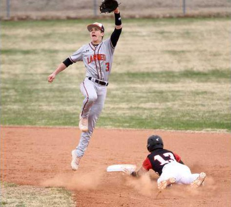 Kingmans William Milford steals second as Carson Smith has to sky for a high throw from catcher Mason Burris.