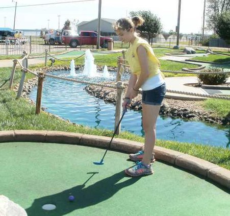 new kl girl golfing