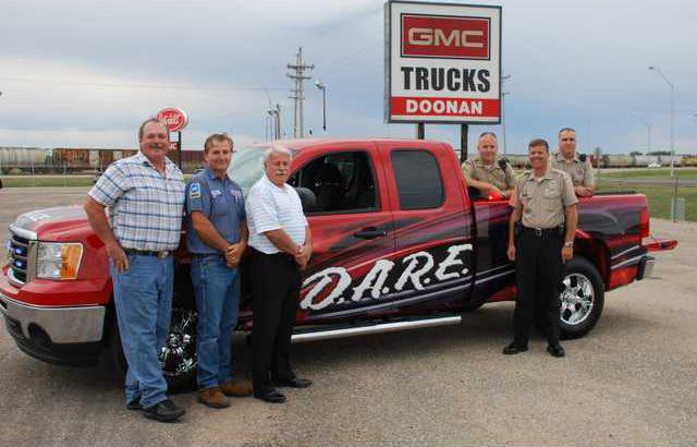 biz slt DARE truck donation