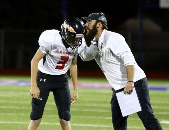 Coach Tad Remy gives Quarterback Dillan Smith the next play..jpg