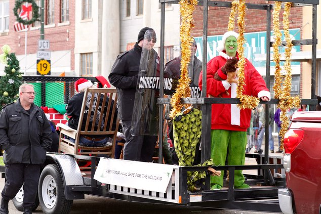 The LCMHF officers lock up the Grinch to take first place in the float division..jpg