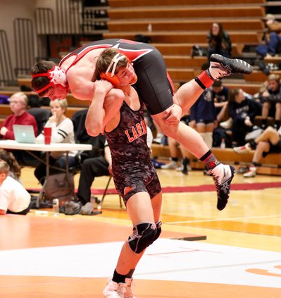 Logan Erway slams his Hoisinginto opponent to the mat and gets the pin..jpg