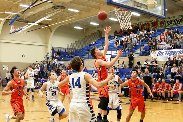 Chance Sanger drives the lane and scores..jpg