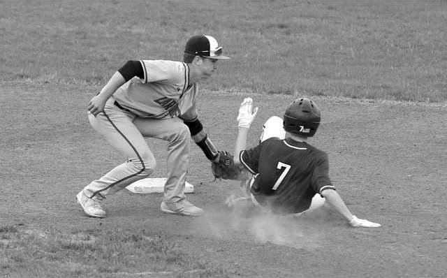 Larned27s Carson Smith puts the tag on Ty Miller bw