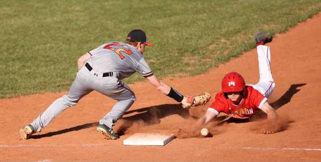 The ball gets under Alex Bargers glove and Hesstons is safe.