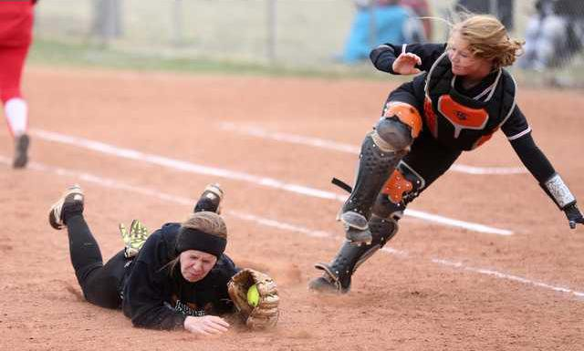 spt jf Lynz Myrick holds on to the ball after her collision with Shaylee Martin for out two of the inning