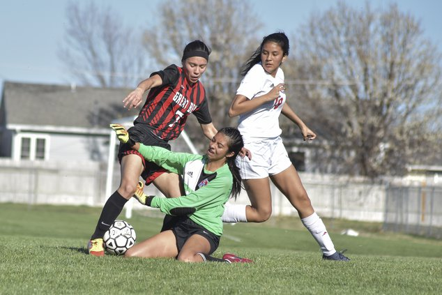 spt_hg_(7) Dodge City's goalie blocks Mayra Ramirez shot..jpg