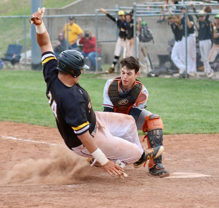 Jack Stelter makes contact for a single in game two of the double header..jpeg