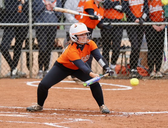 Alea Makings lays down a bunt to score Baylea Perez from third..jpeg