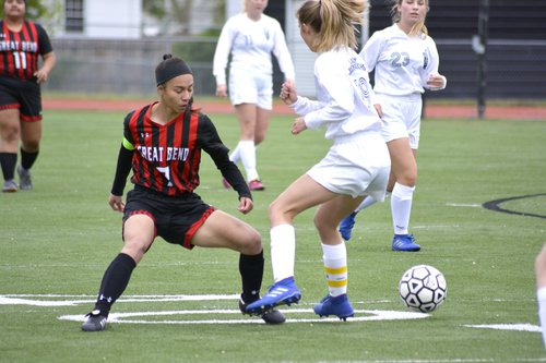 Great Bend's Mayra Ramirez (7) tries to recover the soccer ball from a TMP defender during Monday night's game.