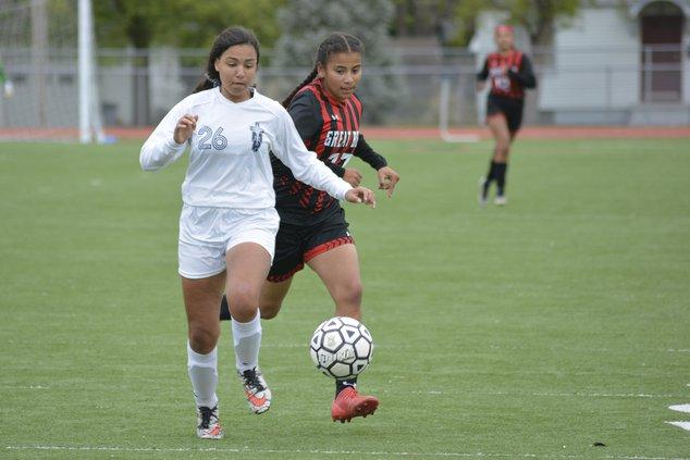 Yulisa Valdez (27) chases after the soccer ball against TMP defender (26).jpg