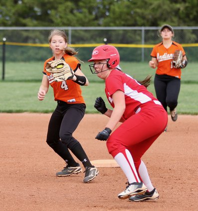 Kendra Grandy tries to run down a Hoisington baserunner..jpeg