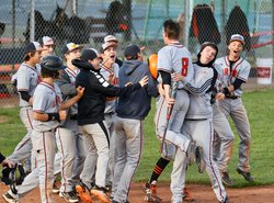 The Indians celebrate after Jack Stelter's winning RBI in game one..jpeg