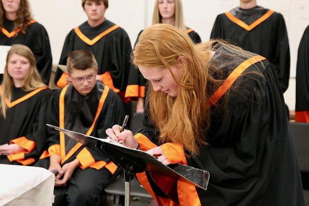 edu_vlc_LHS Sophomore Nikki Taylor signs the Larned High School's NHS registry.jpeg