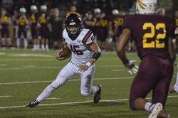 spt_hg_Dalton Miller (16) runsand coverts a touchdown.jpg