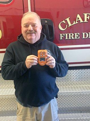 biz_vlc_Claflin fire chief with gas monitor.jpg