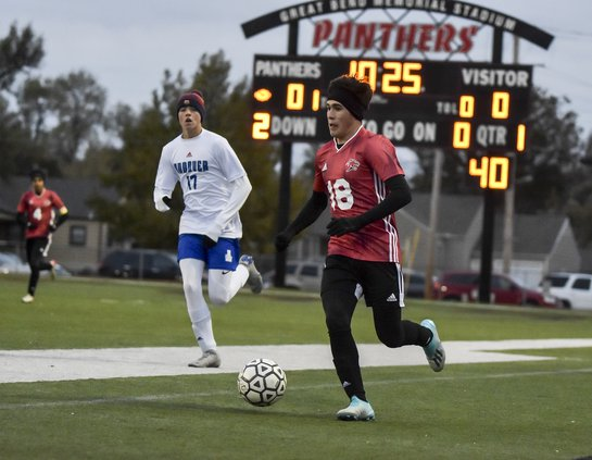 Jaime Arellanes dribles up the pitch.jpg