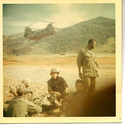 A photo of Edward Saenz (center) in Vietnam.