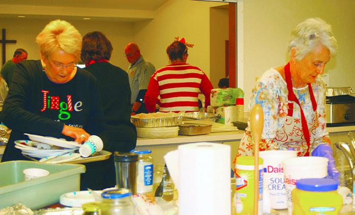 Volunteers wash dishes.jpg