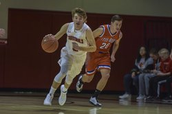 Hoisington's Ryan Woydziak dribbles up the court.jpg