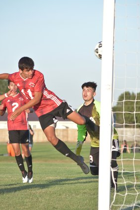 Alex Galindo scores with a header.jpg