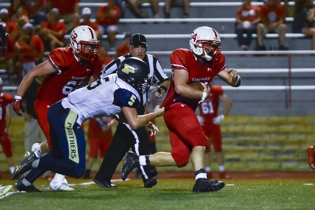 Hoisington's Joshua Ball carries the football