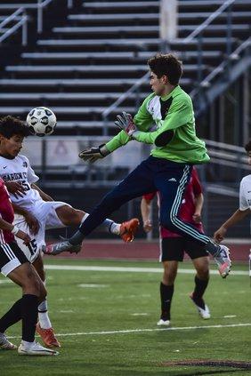 Edwin Chavez soars and saves his goal.jpg
