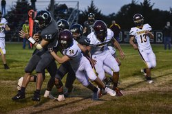 Victoria's Carson Werth pushes Michael Laymon out of bounds