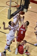 Drew Nicholson scores a basket against Ellsworth.jpg