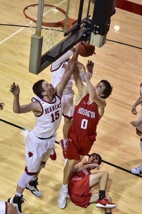 Drew Nicholson scores a basket against Ellsworth.jpg