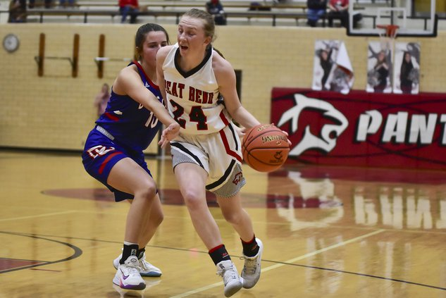 Halle Latham dribbles into the Dodge City's zone.jpg