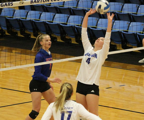 Alyssa Herter, Great Bend freshman, sets the ball for the Cougars