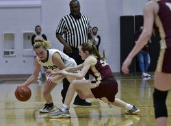 Brynna Hammeke dribbles at the half-court against St. Paul.jpg