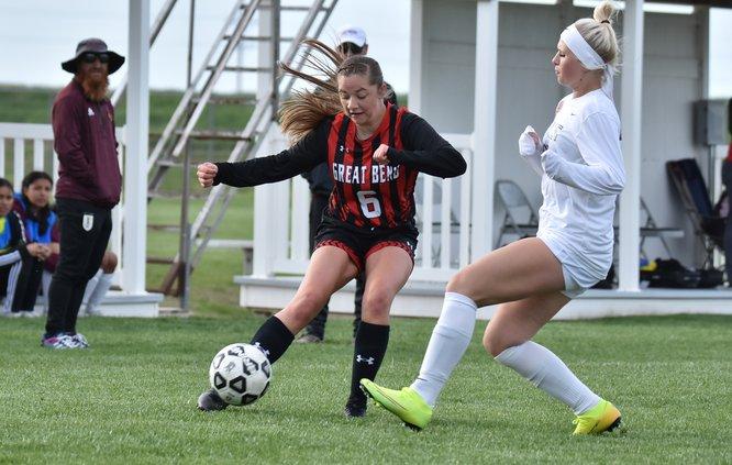 Makenna Tinkler crosses the soccer ball.jpg