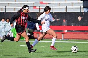 Garden City High School's Marcayla Mcgregor gets past Jazmin Calzada.jpg
