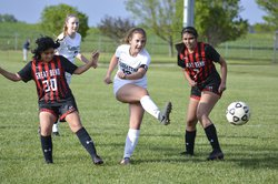 Marleigh Hutchinson shoots between Great Bend defenders.jpg