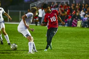 Great Bend's Gustavo Alvarado connects with a drop back pass.jpg
